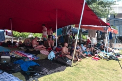 Spectators and competitors relaxing in the shade
